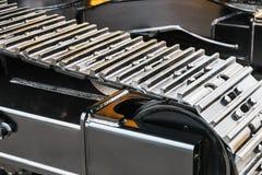 Het kruippakje volgt hydraulica op een tractor of een graafwerktuig stock foto