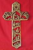 Het Kruis van de geboorte van Christus op rode Textiel Royalty-vrije Stock Foto's