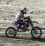 Het kruis van Moto Stock Foto's