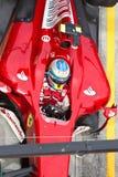 Het kuiltjes maken in van Fernando Alonso bij Maleise F1 Royalty-vrije Stock Afbeeldingen