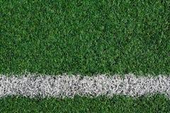 Het kunstmatige gebied van het grasvoetbal stock afbeelding