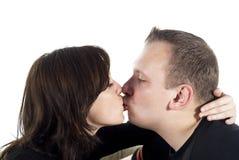 Het kussen van de jongen en van het meisje Stock Foto