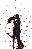 Het kussen van paar en harten Stock Fotografie