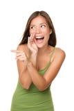 Het lachen en het richten van vrouw Stock Afbeelding