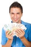 Het lachen mens gewonnen geld stock foto's