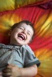 Het lachen van de baby stock afbeelding