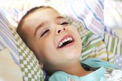 Het lachen van de jongen Stock Foto