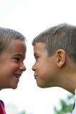 Het Lachen van jongens Stock Foto