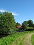 Het landlandschap van de zomer met weg Stock Fotografie