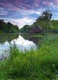 Het landschap van de lente met watermill Stock Afbeelding