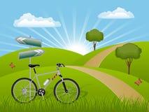Het landschap van de zomer met een fiets Royalty-vrije Stock Afbeeldingen