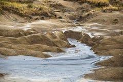 Het landschap van moddervulkanen Stock Foto