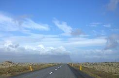 Het landschap van Southermijsland met een weg Stock Foto