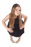 Het langharige meisje dat zich als als pop bevindt Stock Fotografie