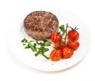 Het lapje vlees van het rundvlees en gebakken tomaten Stock Fotografie