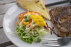 Het lapje vlees van het varkensvlees met zwarte peper stock fotografie