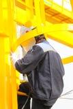 Het lassen op ladder Stock Fotografie