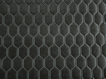 Het leer stikte zeshoek of honecomb zwarte glanzende textuur stock foto's