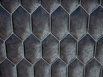 Het leer stikte zeshoek of honecomb zwarte glanzende textuur royalty-vrije stock foto's
