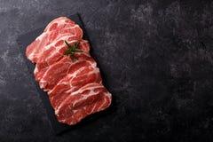 Het lendestuk van het plakkenvarkensvlees royalty-vrije stock afbeeldingen