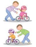 Het leren om een fiets te berijden Stock Foto