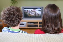 Het letten op TV stock afbeelding
