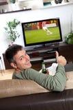 Het letten op TV Stock Foto's