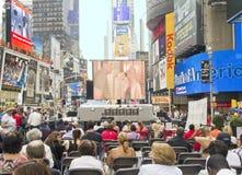 Het letten van een op Film in Times Square Stock Foto's