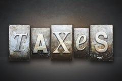 Het Letterzetsel van het belastingenthema stock afbeelding