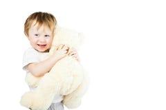 Het leuke grappige meisje van de zuigelingsbaby met groot stuk speelgoed draagt Stock Foto