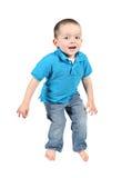 Het leuke jonge jongen springen royalty-vrije stock afbeelding