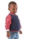Het leuke jonge zwarte jongen kijken stock foto