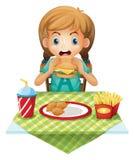 Het leuke meisje eten Stock Foto's
