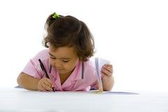 Het leuke meisje schrijven Stock Fotografie
