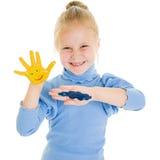 Het leuke meisje spelen met kleuren Stock Fotografie