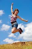 Het leuke meisje springen Stock Foto
