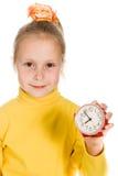Het leuke Meisje toont de klok Royalty-vrije Stock Afbeeldingen