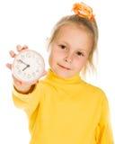 Het leuke Meisje toont de klok Stock Afbeelding