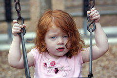 Het leuke Meisje van de Roodharige op een Speelplaats (5) Royalty-vrije Stock Foto's