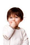 Het leuke schadelijke gezicht van de babypeuter Stock Foto's