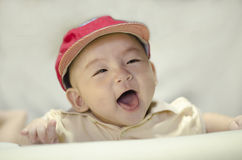 Het leuke zuigeling glimlachen Royalty-vrije Stock Fotografie