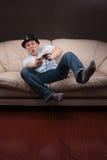 Het leunen gamer Stock Foto's