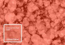 Het leven koraalkleur van het Jaar 2019 Bokehachtergrond met koraal in in kleur stock fotografie