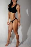 Het lichaam van een jonge atletische meisjes witte achtergrond Royalty-vrije Stock Fotografie