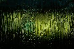 Het licht door het donkergroene glas Stock Foto