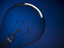 Het licht van de bol over blauw Stock Foto