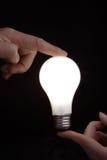 Het licht van de holding Royalty-vrije Stock Afbeelding