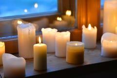 Het licht van kaarsen Stock Foto's