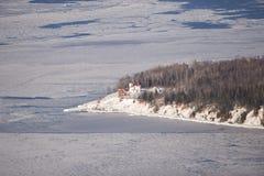 Het lichte huis van het Eiland van de framboos in de winter Stock Afbeelding
