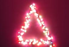 Het lichte onduidelijke beeld van de kerstboom Stock Foto